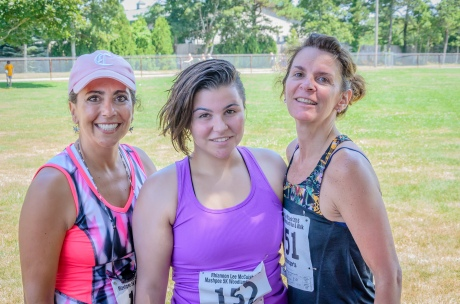 "Corinne W, Rachael + Lisa Murphy. Lisa: ""I've been a non-smoker for 3 years now. Running keeps me healthy and away from smoking. Running is addictive too but in a good way."""